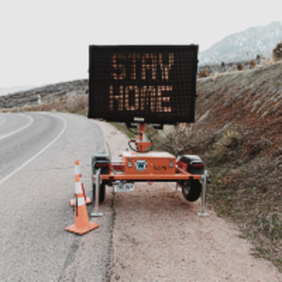 Stay Home road sign