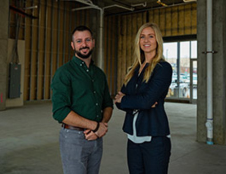 Man and Woman standing in construction site