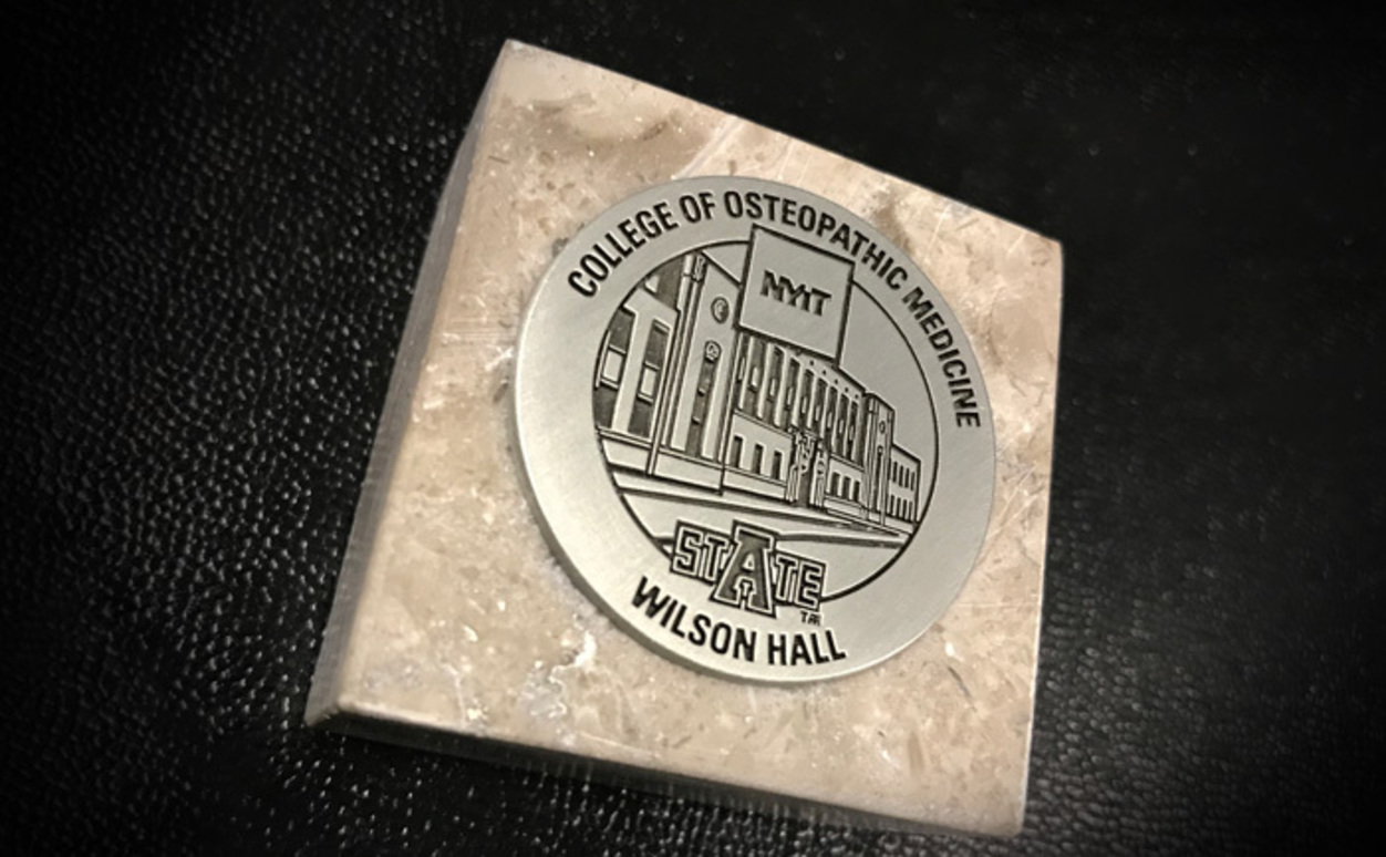 A momento from Wilson Hall to graduates