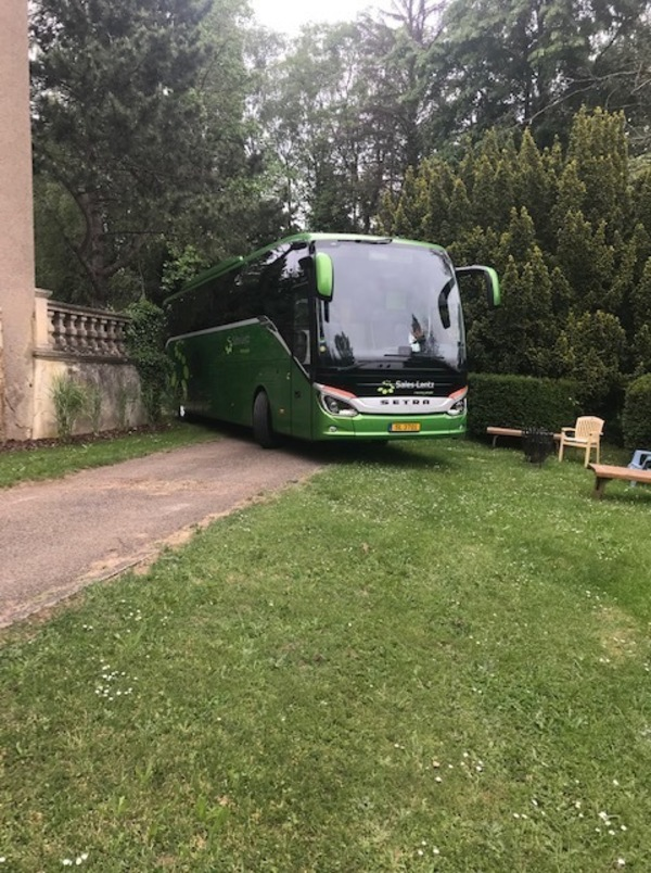 Bus driving in to the Château grounds
