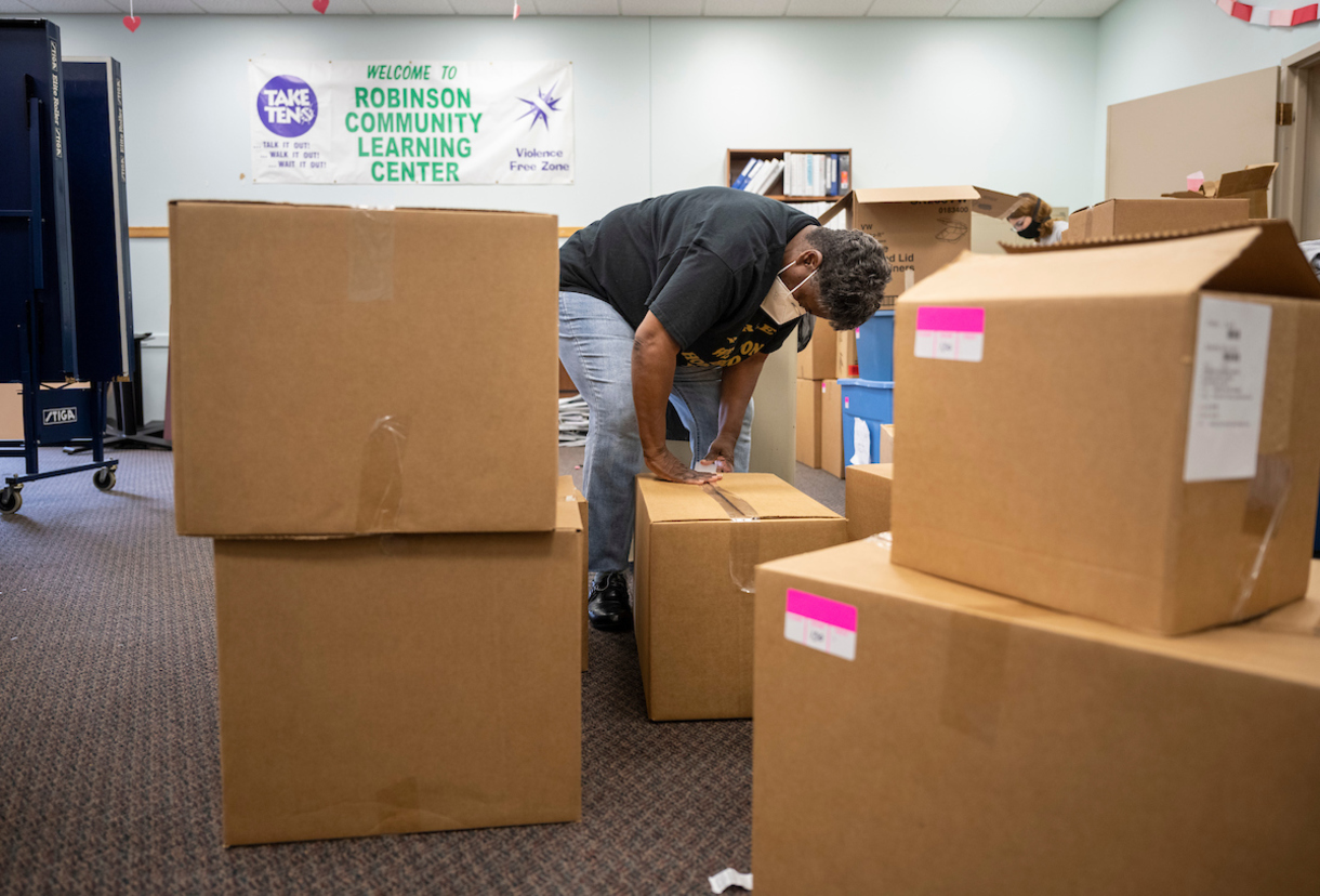 LuElla Webster, the RCLC's adult program director, packs boxes for the move.