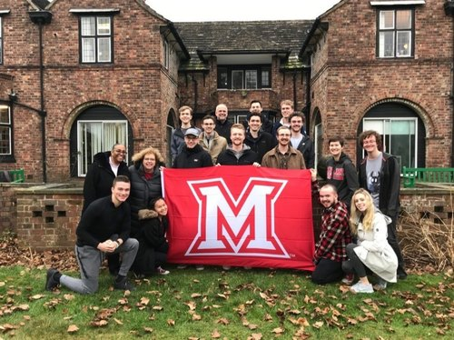 CIT students group photo holding Miami flag