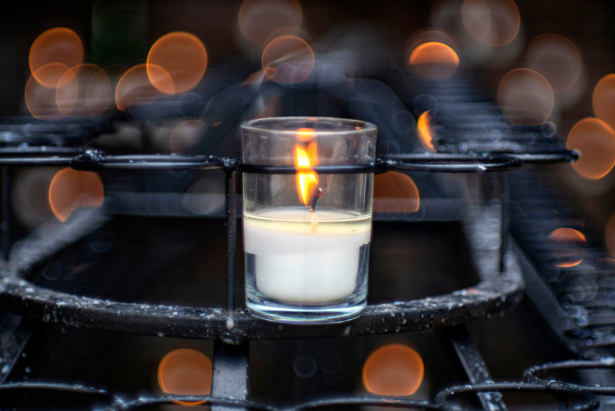 Photo of a candle burning at the Grotto.
