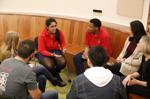 group of 7 people engaging in dialogue