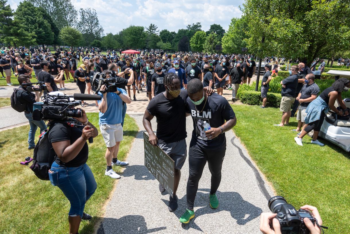 Photo of Notre Dame football players leading a Black Lives Matter march held on Juneteenth, Friday, June 19.