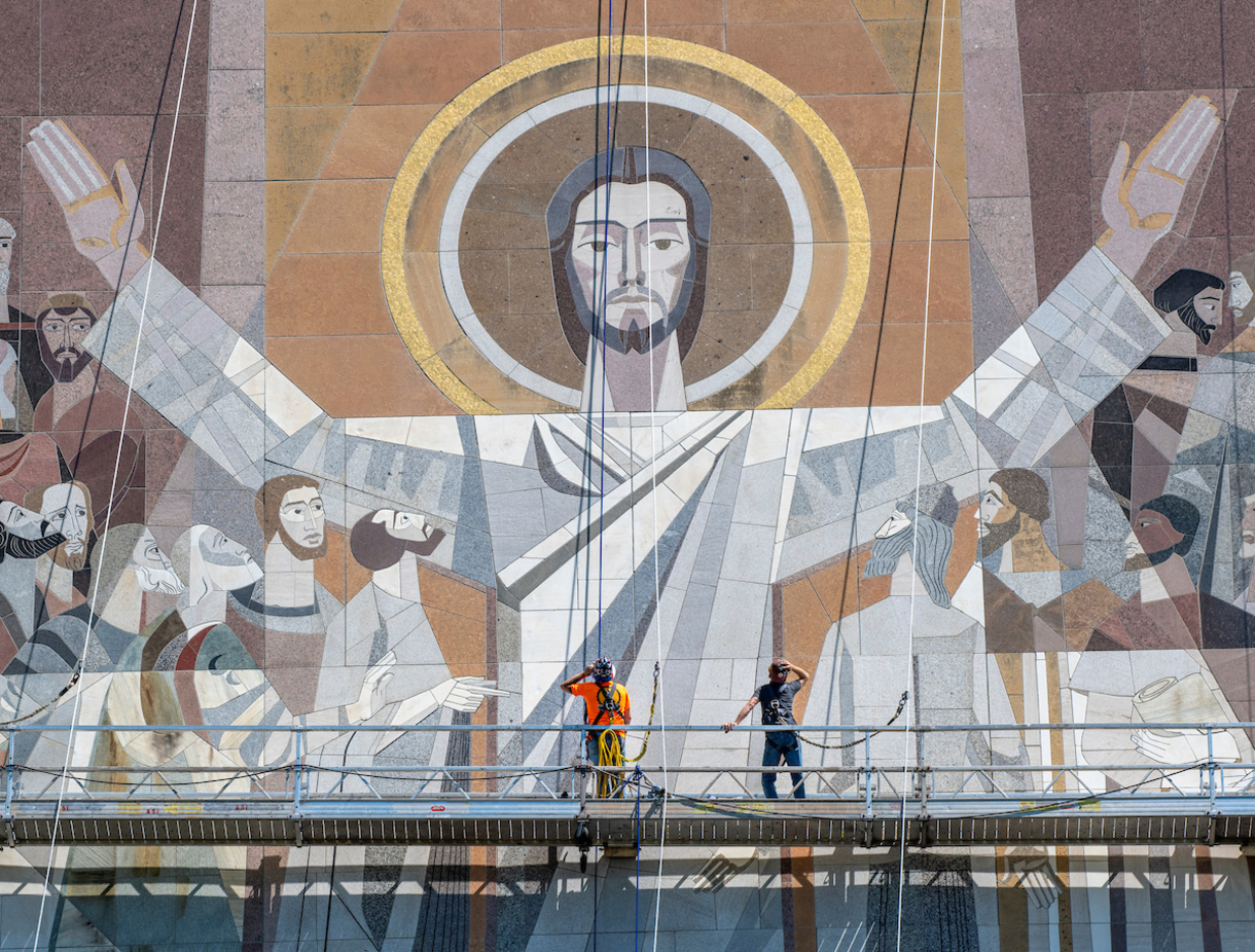 Photo of Word of Life mural with maintenance team on scaffold