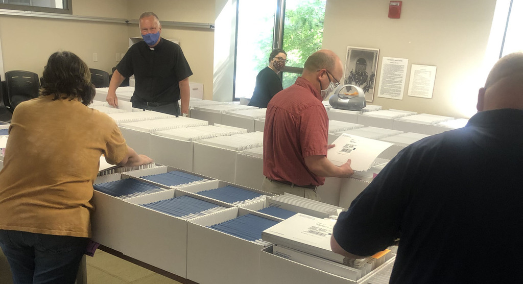 Staff in the Office of the Registrar recently sorted and shipped more than 3,200 diplomas to graduates.