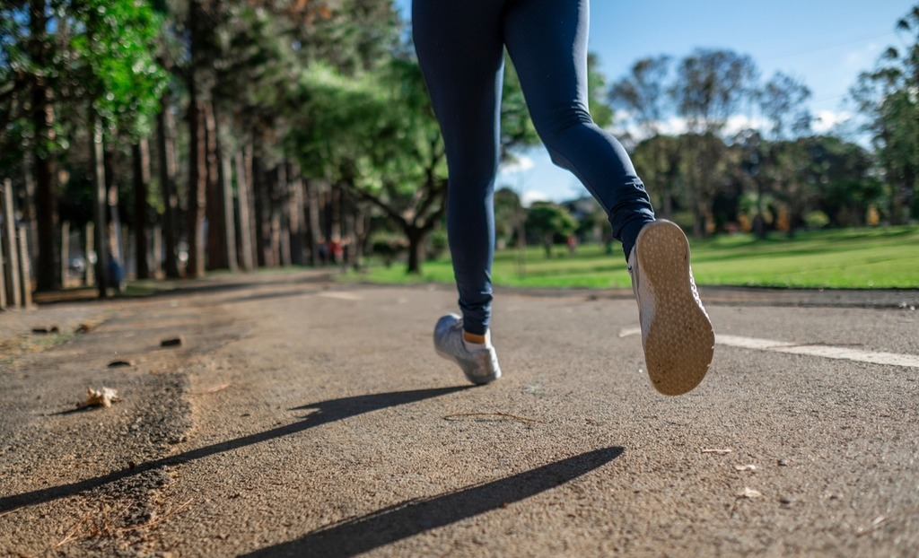 Woman jogging on an outdoor path.