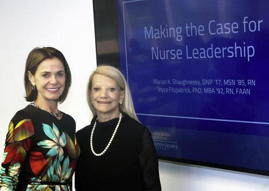 Marian K. Shaughnessy and Joyce Fitzpatrick standing in front of smart board that reads Making the Case for Nurse Leadership.