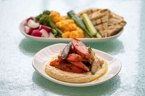 Photo of hummus and veggie plates for Rohr's.
