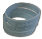 Picture of the light blue rubber People Inc. Heroes awareness bands.