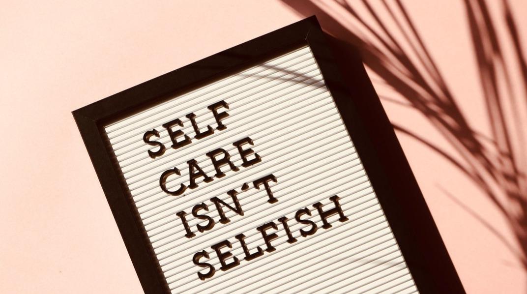 Sign that says self-care isn't selfish.