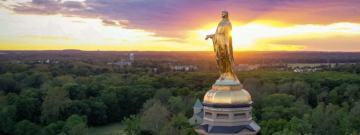 Photo of the Virgin Mary atop Main Building.