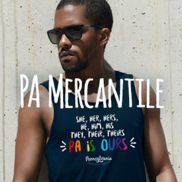 A young man wearing a PA is ours, pride tank top.