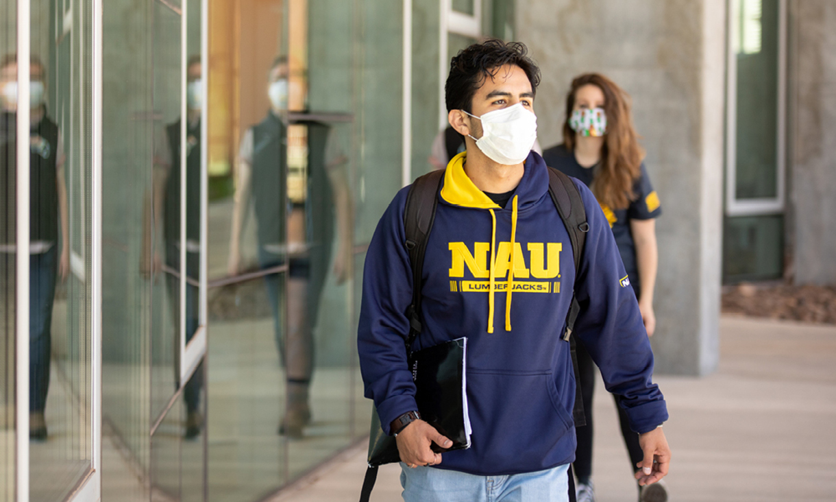 NAU student practicing physical distancing while on campus.