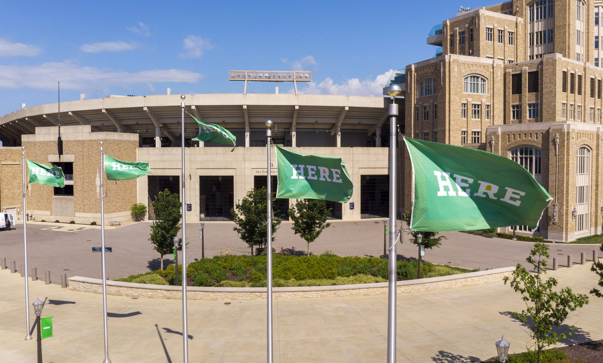 Photo of HERE flags outside Notre Dame Stadium.