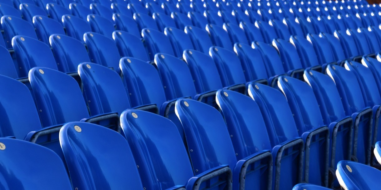 Photo of empty stadium seating.