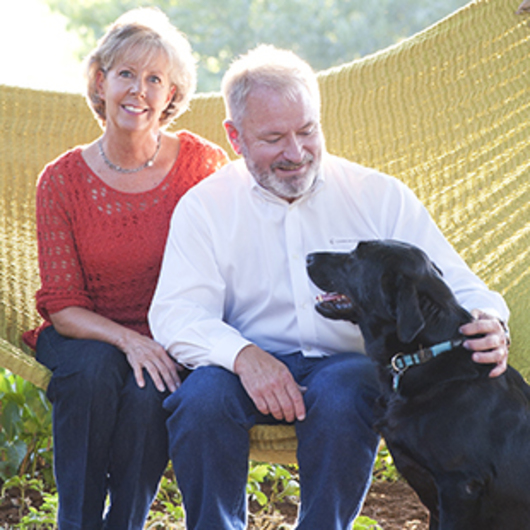 Angie and Harold Cannon with their dog, Lila.