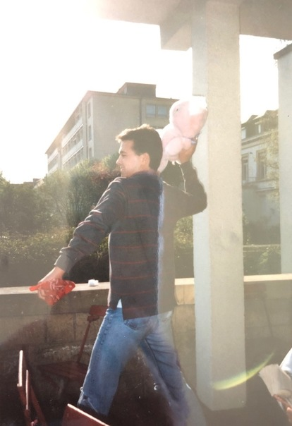 male student throwing stuffed bunny