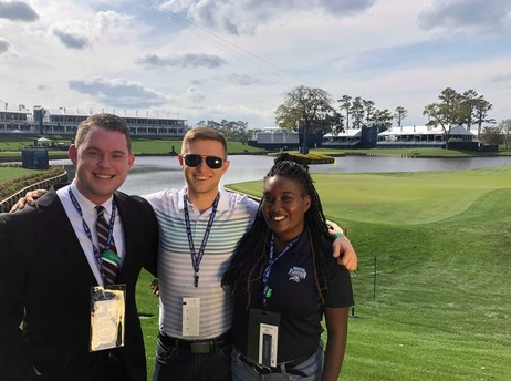 three UNF students posing for the camera at TPC Sawgrass