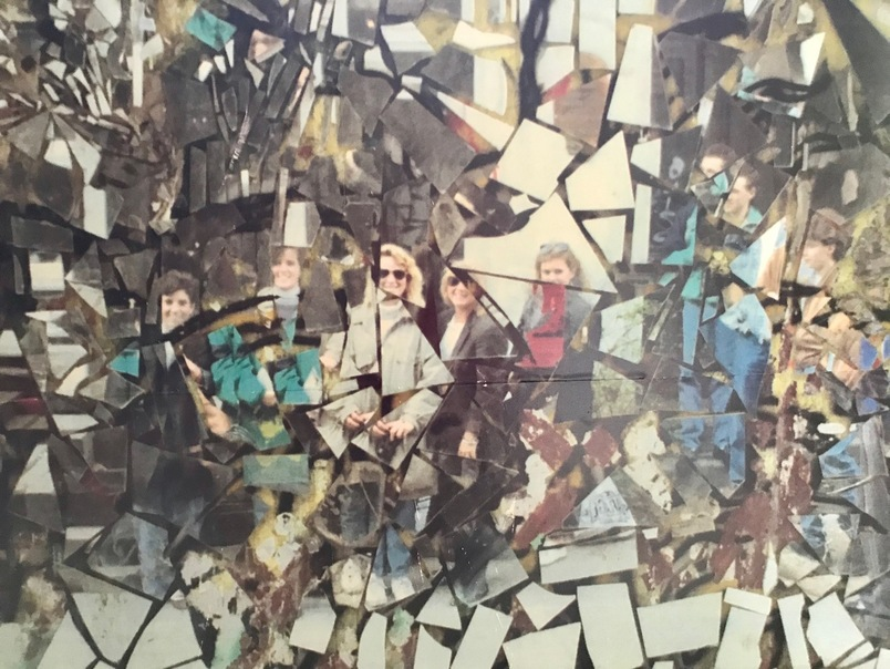 Shattered picture of students at the Berlin Wall