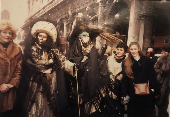 MUDEC girls with masked people at Carnival in Venice