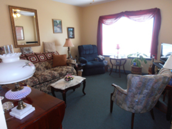 A livingroom at a Senior Living apartment, decorated in a comforting style.
