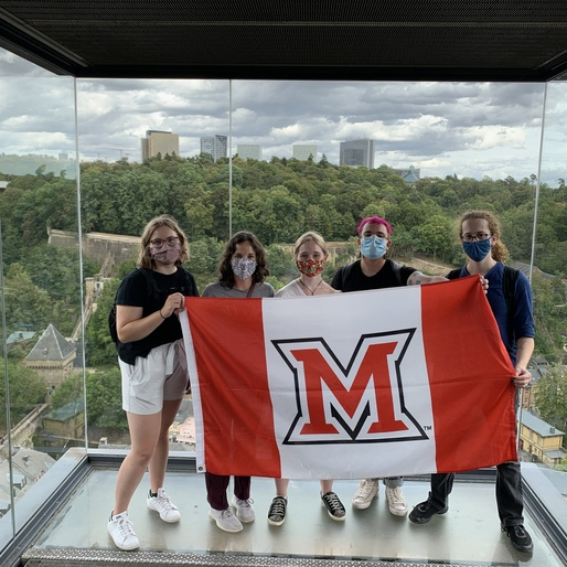 Students with Miami flag in a glass-enclosed elevator