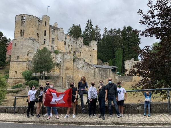 Students with Miami flag and Beaufort Castle in the background