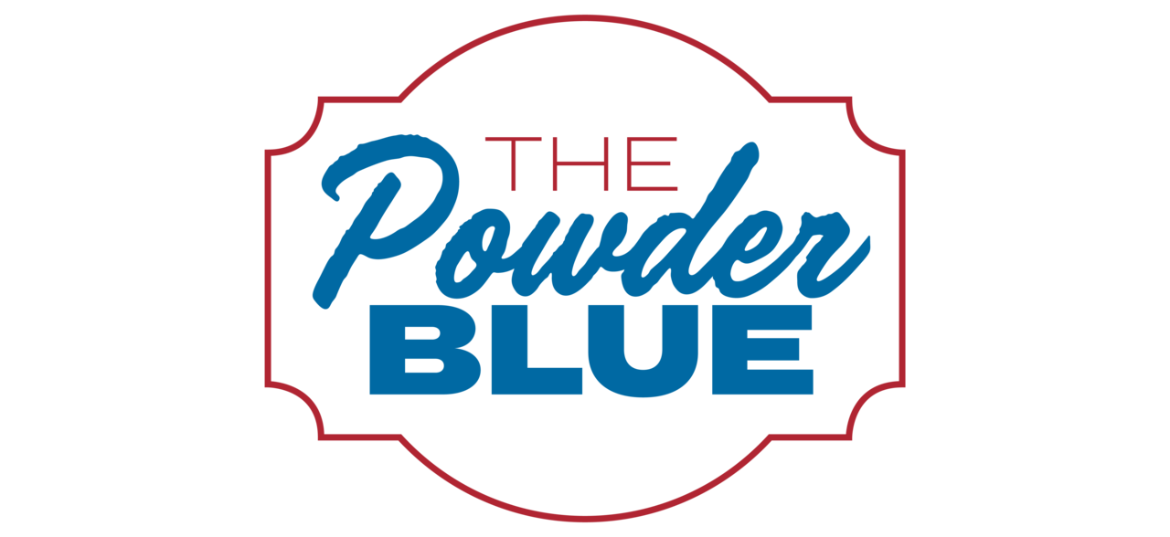 Logo that reads: The Powder Blue in red and light blue