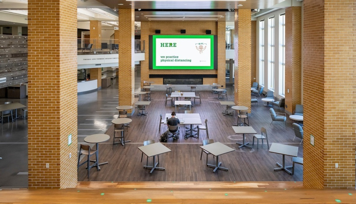 Photo of the food court area at Duncan Center with one person in the room.