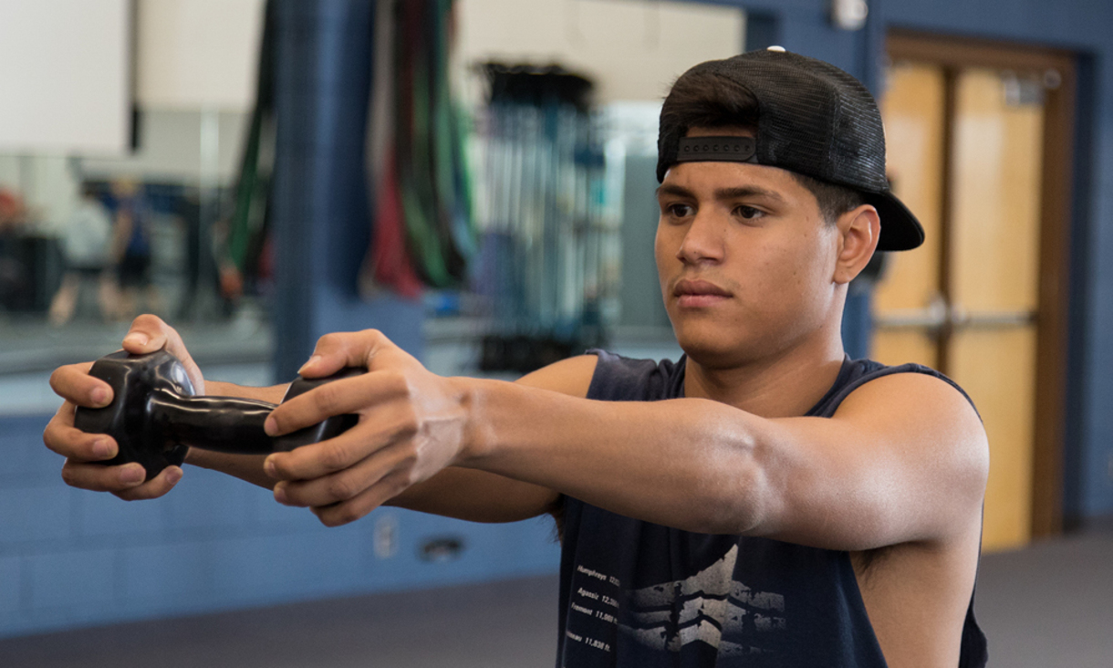 NAU student exercising along with a virtual class.