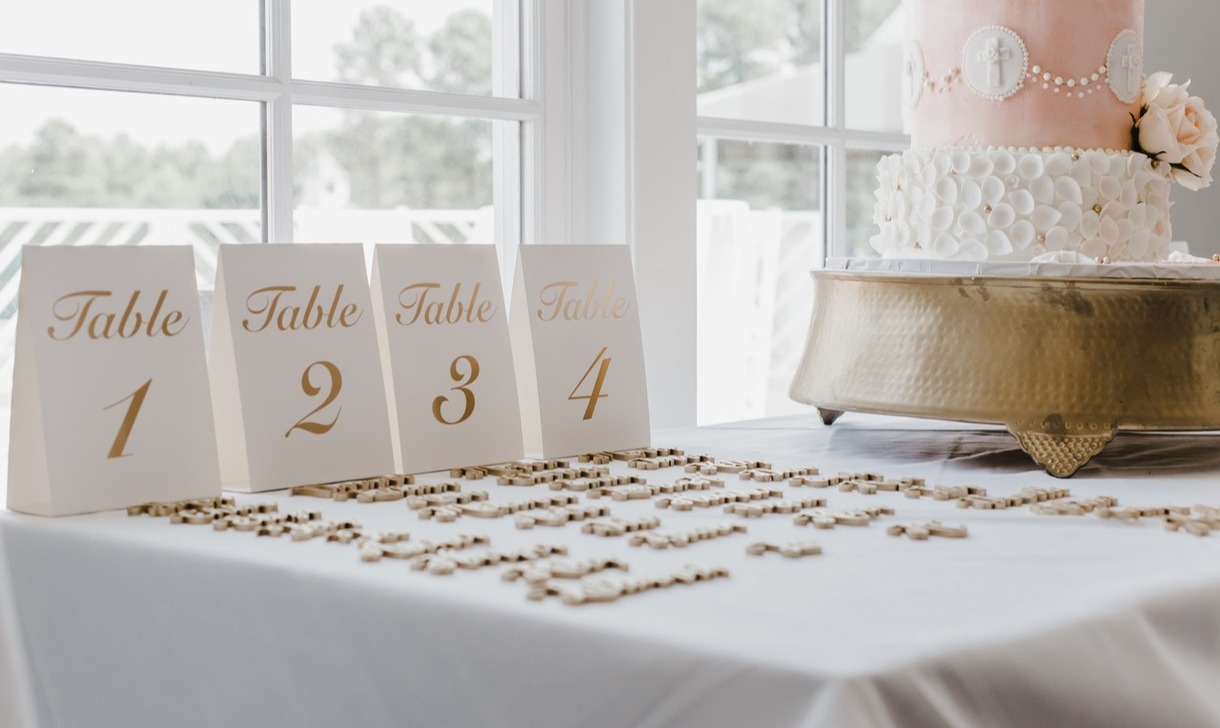 Photo of place settings and a wedding cake