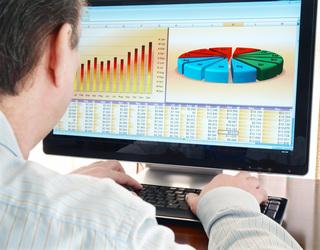 A person reviews data o a computer screen