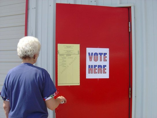 Woman walking into voting location