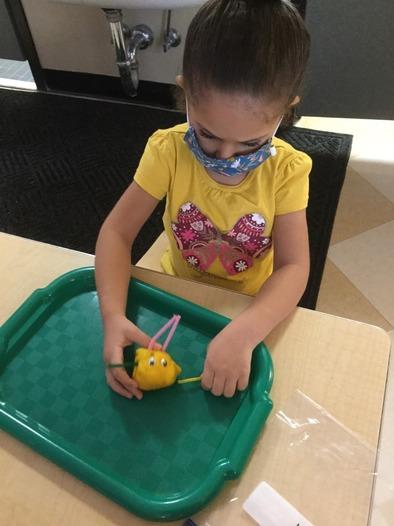 Preschool girl interacting with crafts