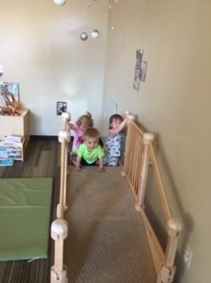 Young toddlers on play ramp