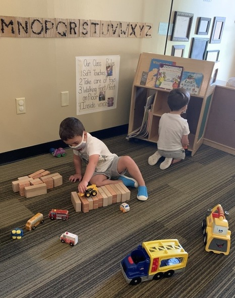 Preschool aged student playing with blocks