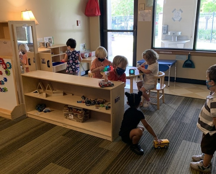 Preschool class interacting with each other during play