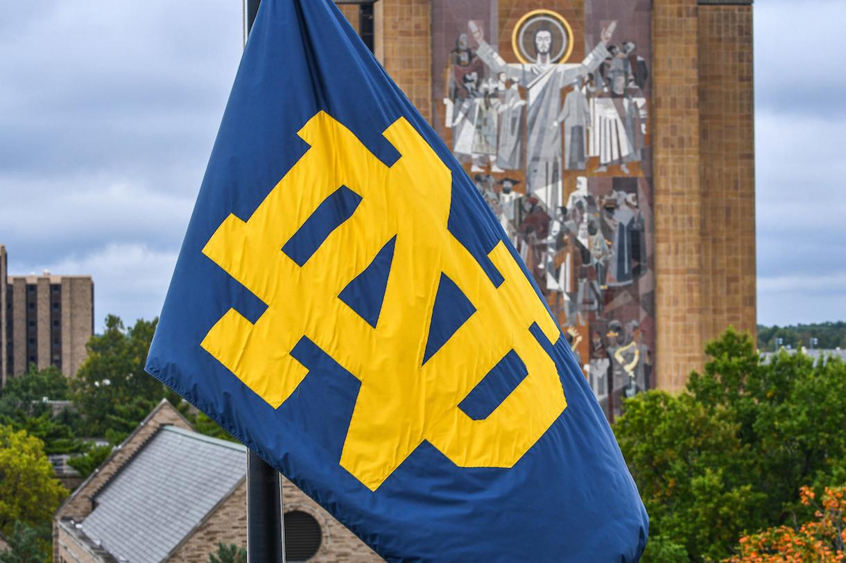 Notre Dame monogram flg flies at the top of Notre Dame Stadium