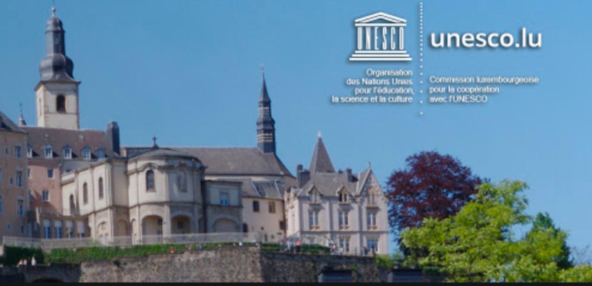 UNESCO logo over skyline of Luxembourg