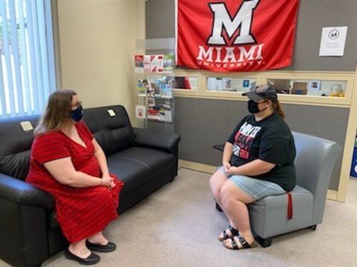 TRIO student chatting with advisor