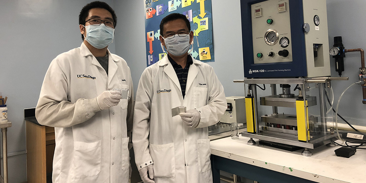 researchers hold prototype battery