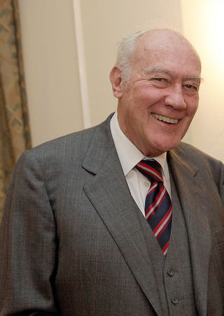 Man smiling in suit