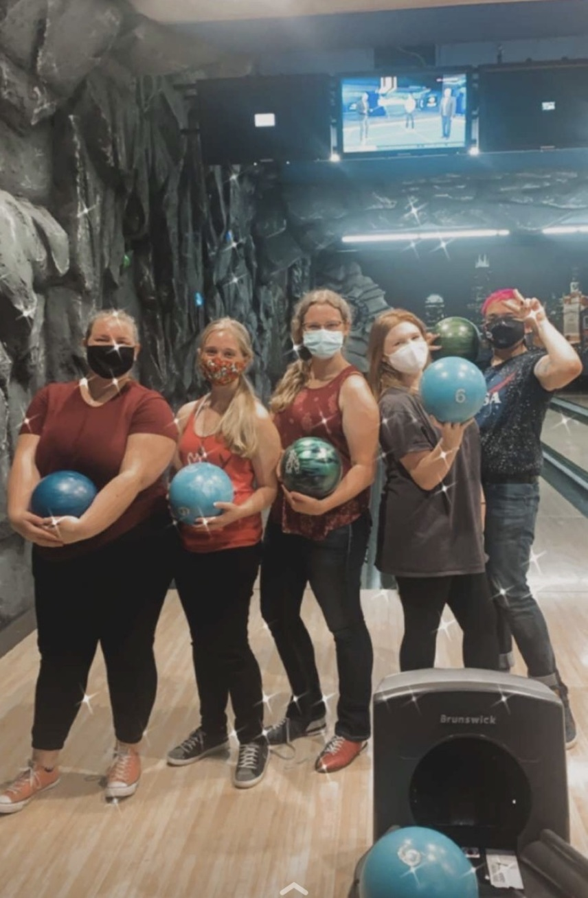 5 Students with bowling balls at an alley