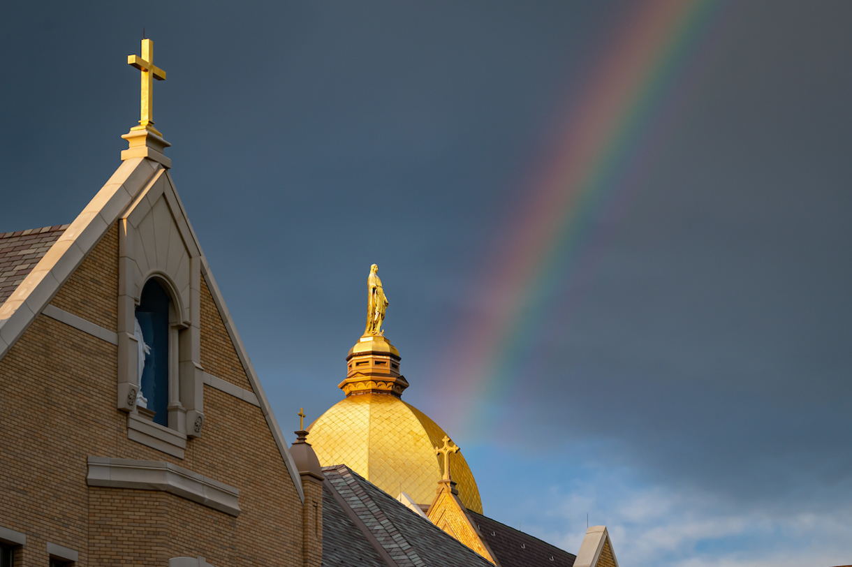 Rainbow behind Corby Hall and the Golden Dome (Photo by Matt Cashore/University of Notre Dame)