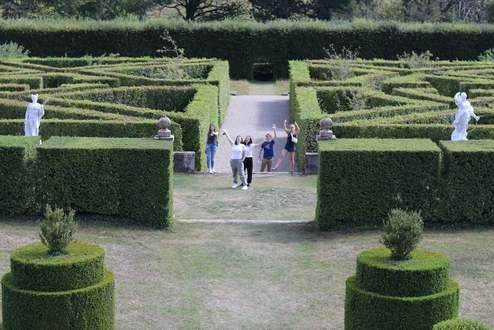 Students pose in gardens of Grand-Chateau d'Ansembourg