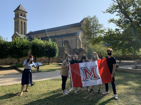 Students holding a flag at Orval Abbey
