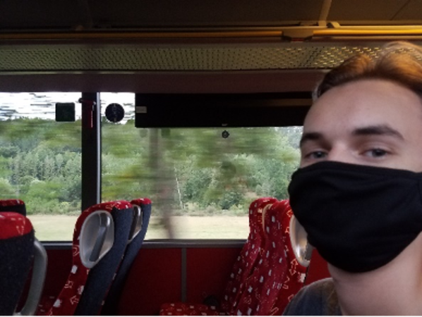 man with mask on bus