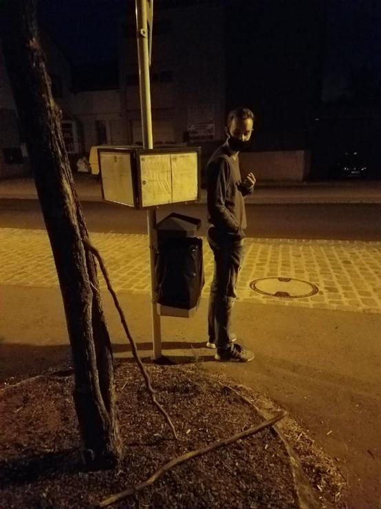 Man at a bus stop at night